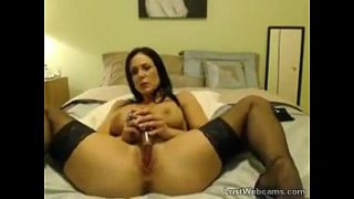 Busty MILF toys her shaved pussy on webcam